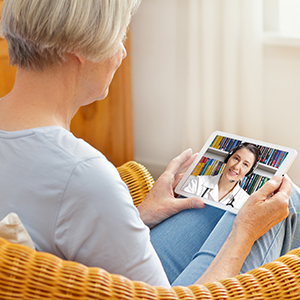 Mountain West patient talking to a doctor via TeleHealth.